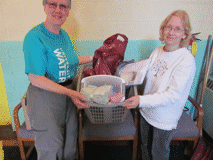 HELPING HANDS - Wendy Smith (at right), a parishioner from St. Margaret's Anglican, delivers household goods donated by the congregation for the Syrian refugee family who will be sponsored by the archdeaconry. St. Margaret's is kindly covering all items in the bathroom and personal supplies categories of a long list of furniture and supplies. Ann Deveau (at left) from the cathedral will put the items into storage until the family arrives in Fredericton. The timing is unknown because the archdeaconry is on a waiting list to choose a family.